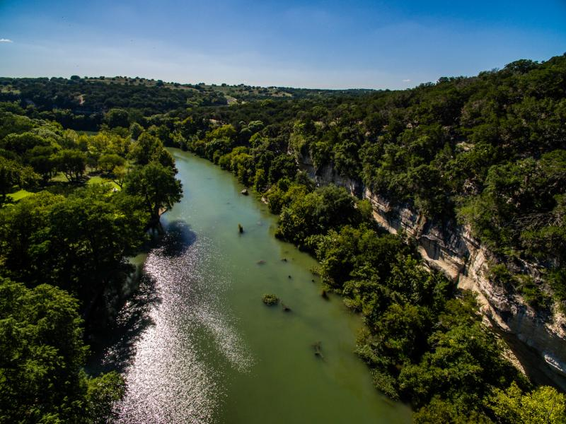 creek and cliff land in texas