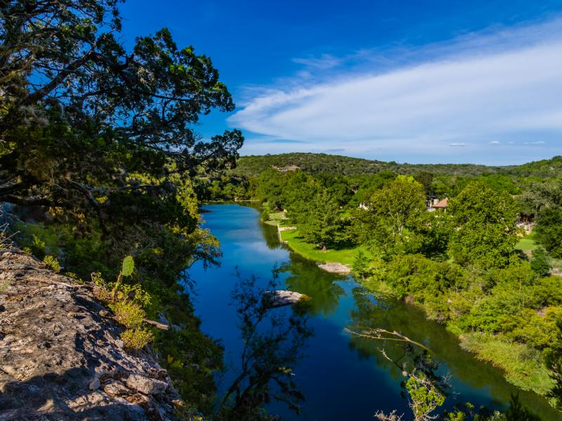 view of cliff and creek land for sale in texas