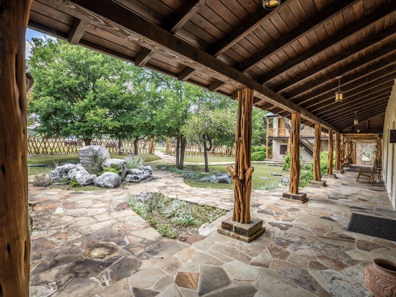 covered porch texas ranch for sale