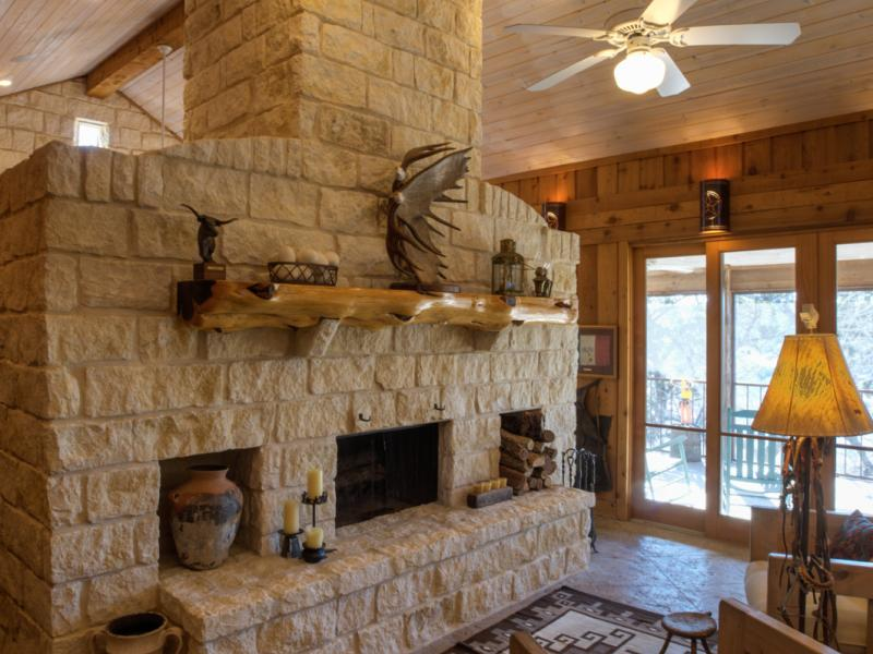 Eagle Ridge Ranch stone floor to ceiling wood burning fireplace