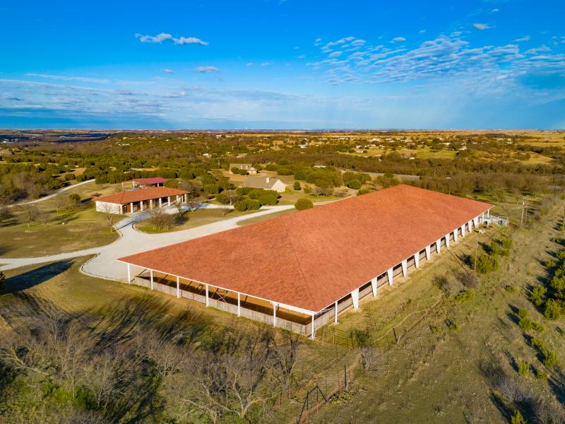 The Cresson Horse Ranch arena has Mexican Tile Roof for sale in North TX